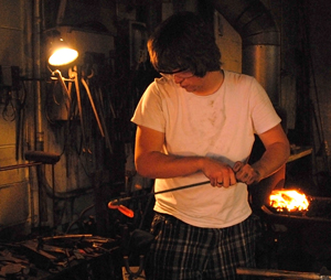 Student using blacksmith tools