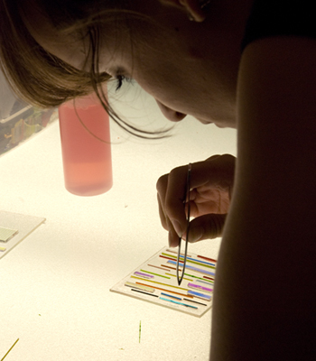 Student working with glass